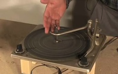 An experiment using a turntable to test nail finishes.